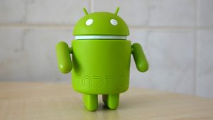 The official Android mascot standing on a table.